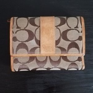 Coach signature tan and brown trifold wallet